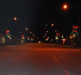 a small saskatchewan town street with christmas lights, on a cold winter night.